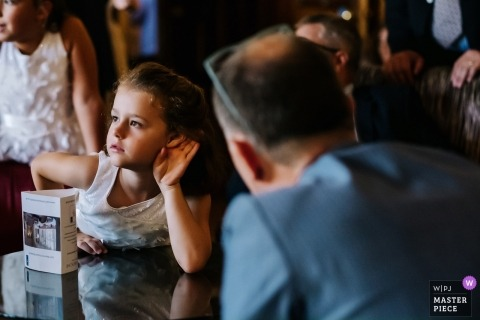 Warren House Wedding Reception Photography | A flowergirl requests that a guest should speak up