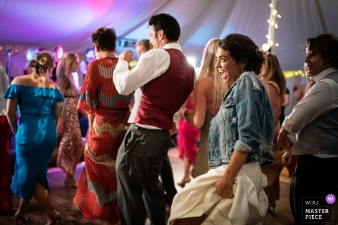 Merton Grange, Dorset Wedding Reception Photos - Bride breaks the line dance - Marlow UK wedding photographers