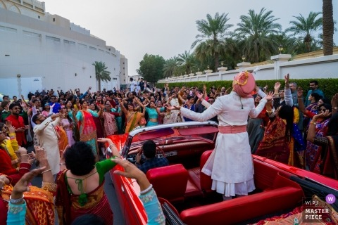 Sofitel Hotel, Bahrain Wedding Photojournalism | The groom with his entourage dancing his way in to the wedding venue.