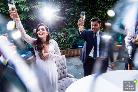 Caracas bride and groom photo during toast | Raising glasses for Cheers!