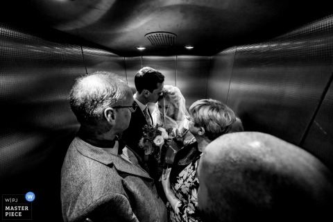 Neroberg Wiesbaden Germany Doucmentary Wedding Photo of Bride and groom in elevator