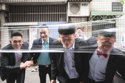 Taiwan wedding day photo - Groom and groomsmen was passed challenges prepared by bridesmaid.