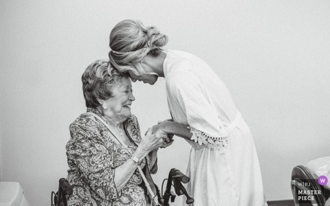 Scott Conference Center Wedding Reception Venue - Photo of the grandmother and bride holding hands