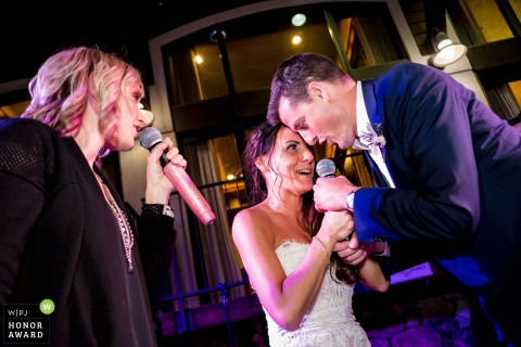 West Shore Cafe wedding venue pictures | Bride and Groom sing together