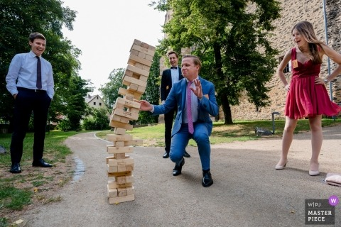 Schloss Romrod Photos of Fun at the wedding reception with wooden tower of Jenga falling over