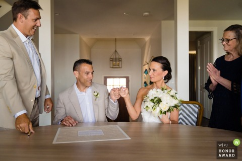 Private Home Wedding | Photo of Bride and Groom signing Ketubah