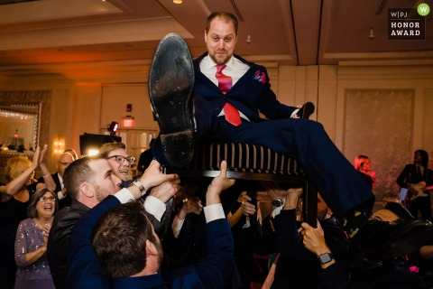 Four Seasons Boston - Wedding Photography | Groom during Hora dance, Photographed by Nicole Chan Photography