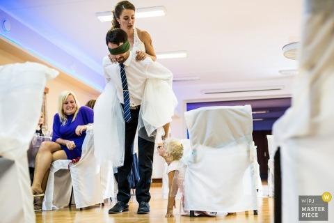 Váňův statek wedding photojournalism - Spectators of the piggyback ride game