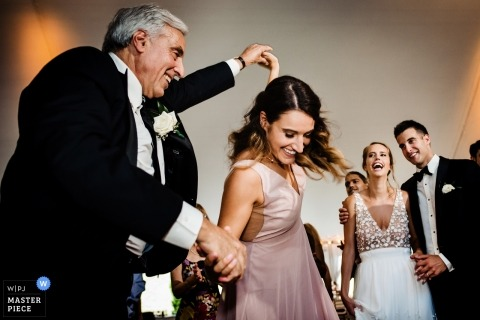 Vermont Wedding Photos - The grooms dad and sister dance while the bride and groom look on during the reception at Hildene, Manchester