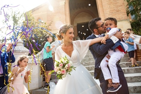 Wedding photojournalists capture action and emotion at the event.