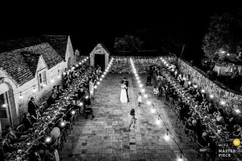 Puglia outdoor wedding reception photos at night in black and white.