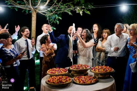 Ristorante Scola, Castelbianco - Italy wedding photo of champagne popping going wrong