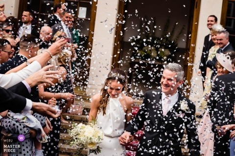 London, UK wedding reportage photos of confetti over bride and groom