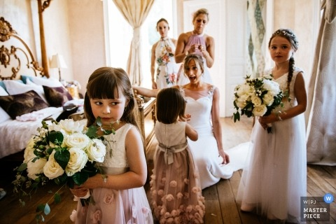 Chateau de La Motte Husson, France Wedding Photos | Bride and bridal party minutes before the ceremony