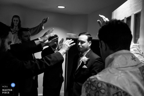 Our Lady of Snows, Lake Tahoe NV Wedding Photography | Groom blessing and prayer before ceremony