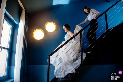 Budapest- Hungary Weddings | Photography of the bride coming down the stairs on her way to the ceremony