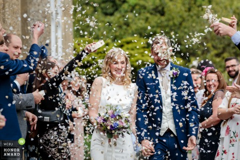 St Julian's Club, Sevenoaks, Kent UK wedding reportage phtoto | The newlyweds are showered with confetti