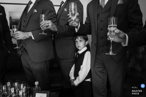 Los Angeles, La Venta Inn Wedding Photos | A young boy watches the groom and his groomsmen during a champagne toast
