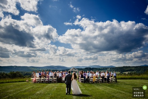 East Burke, Vermont - Inn at Mountain View Farm wedding venue photo | The bride walks down the aisle with her father.