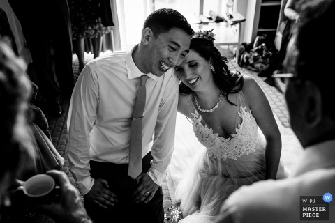 Wedding Photographer for the Dockside Guest Quarters in York Maine | The bride and groom laugh during the traditional tea ceremony on their wedding day