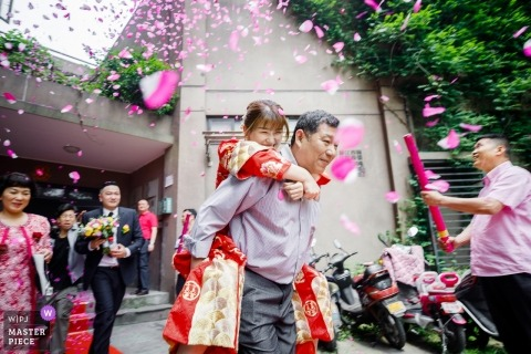 Hangzhou China ceremony photography from actual wedding day of bride getting carried