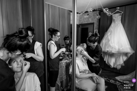 Black and white wedding photo of the bride with her mother as make-up applied in preparation for her wedding at Casa della Sposa