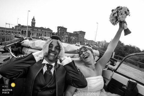 The bride expresses her joy and the groom responds ironically in his own way after their Mantova wedding.