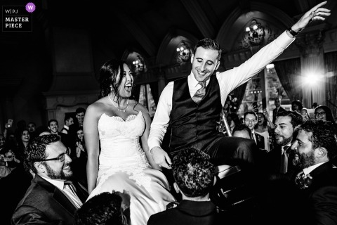 Black and white wedding photo of a bride and groom at the chair dance during their Ashford Estate wedding.