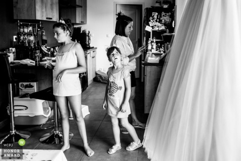 Photo of kids at the wedding getting ready in France