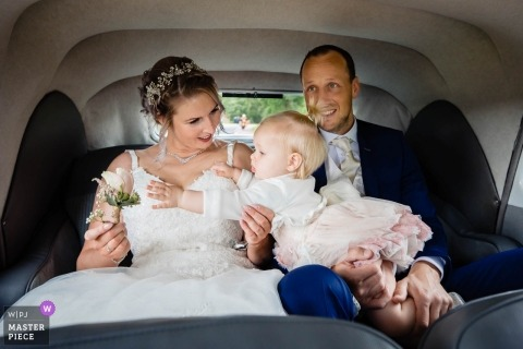 Noord Brabant Dorst wedding photos of the bride, groom and baby in the car