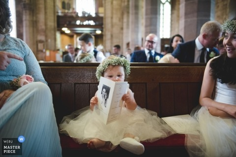 Brewood Wedding Photos of an Early reader at the church ceremony