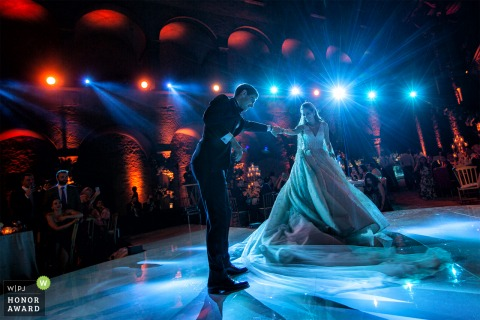 Odescalchi Castle - Bracciano - Italy wedding venue picture | Amazing First Dance under blue and red lights for the bride and groom