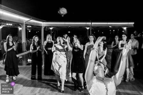 İncek Garden Wedding Photojournalist | Bridesmaids are trying to catch the bouquet