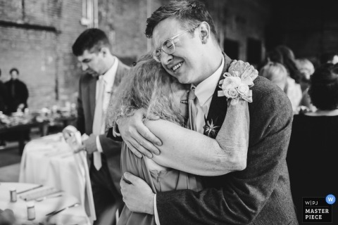 Reception Venue Photography in Ohio - Big emotional hugs by the family