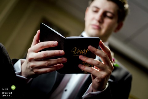 Chicago Illinois wedding photography   Hotel photo of the groom Reading the vows