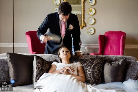 Luttrellstown Castle Photography - Bride fainted on her Wedding Day. Groom Fans Her.
