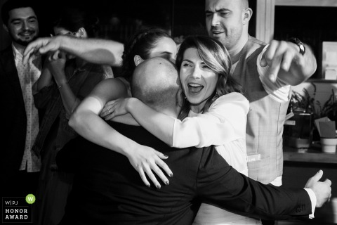 Gradina Lahovari wedding venue photo - Groom gets a hug from friends