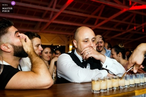 Gradina Lahovari - Wedding Photography of Groom and friends at the bar before shot'o'clock