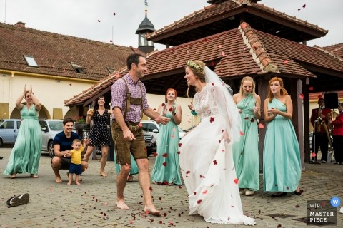 Sudický Dvůr barefoot first dance photos outside with bride, groom and wedding guests.