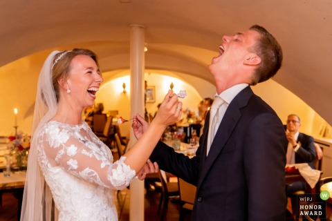 Hotel Kasteel de Essenburgh, The Netherlands wedding venue photo | Fun while eating the wedding cake