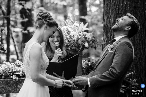 Wellspring Spa Outdoor Wedding Photos | Groom bends over backwards laughing during wedding ceremony