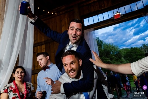Kitz Farm in Strafford New Hampshire wedding photos of the groom gets the party started with his best man