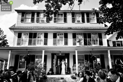 The Preserve at Chocorua in Tamworth, NH wedding venue photo | The bride and her father enter the outdoor ceremony from the front porch of the farmhouse