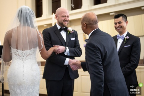 Maryland Wedding Photo - Ceremony at Church | The father giving daughter to groom