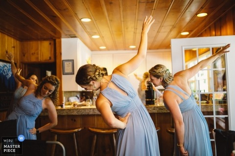 Tahoe Vista, CA Pre-ceremony photography of the stretches of the bridesmaids at home