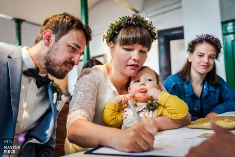 Germany Wedding Ceremony, On Location Photography - Interesting moment with the child during the signatures