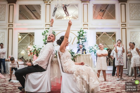 Ramada hotel Sofia wedding venue photo of the game: Yes of No - Bride and groom laughing