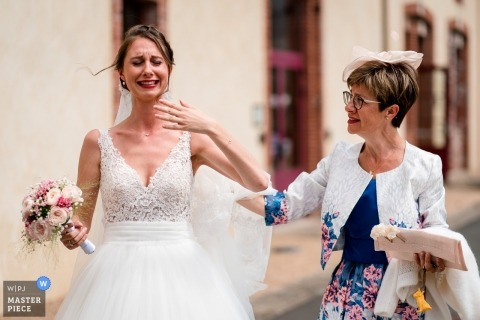 The bride with her mother gets emotional before the wedding ceremony at Domaine des Lys.