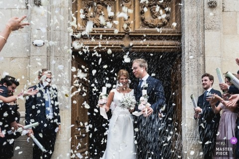 Photo of the bride and groom as they exit the church at their Bordeaux, France wedding ceremony.
