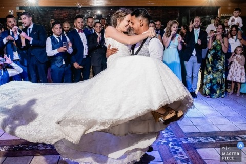 Photo of the bride and groom first dance during their Mirador de Cuatro Vientos wedding reception party.